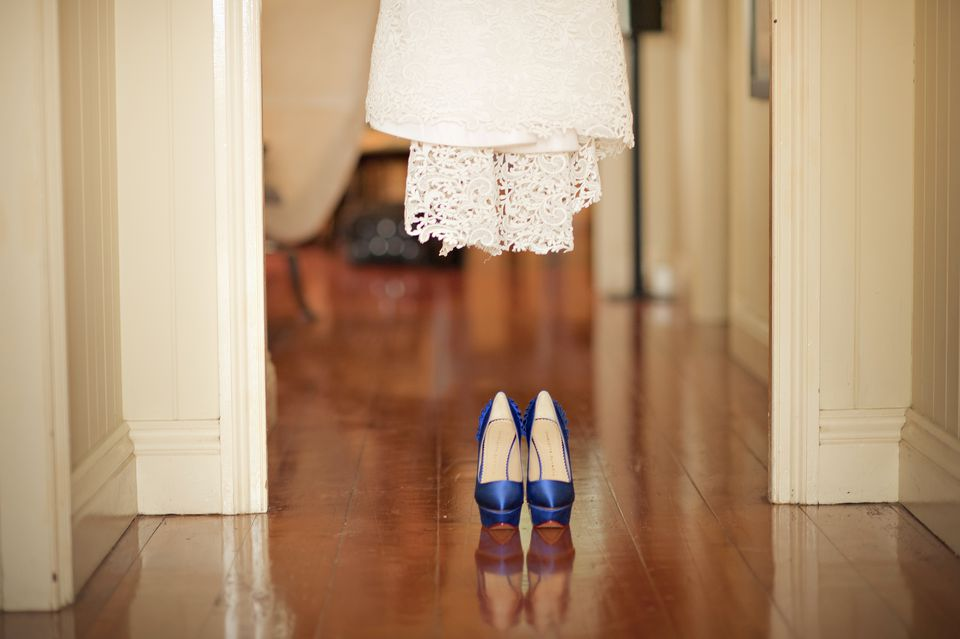 Bottom of dress in hallway with blue shoes