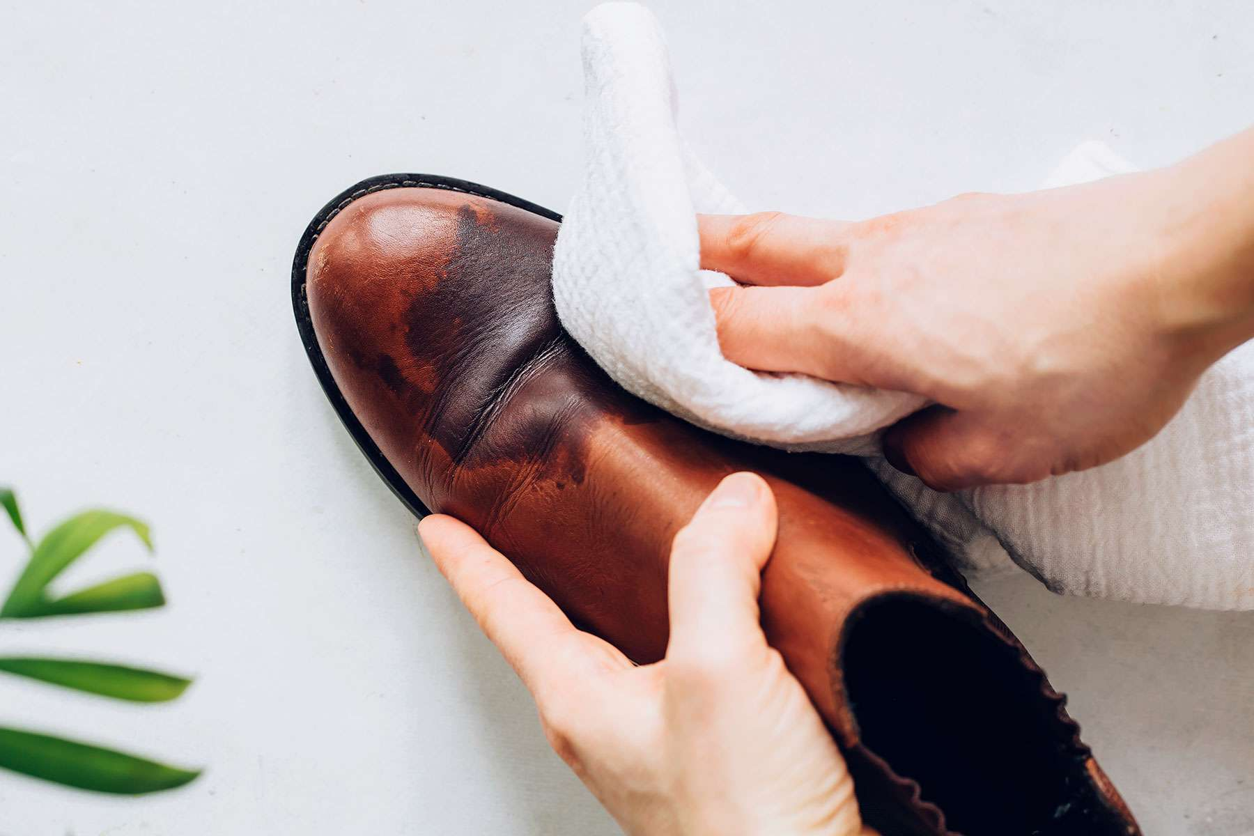 using a soft cloth on shoes with cement stains