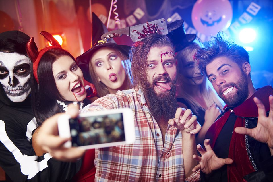 A group of people at a Halloween party playing games