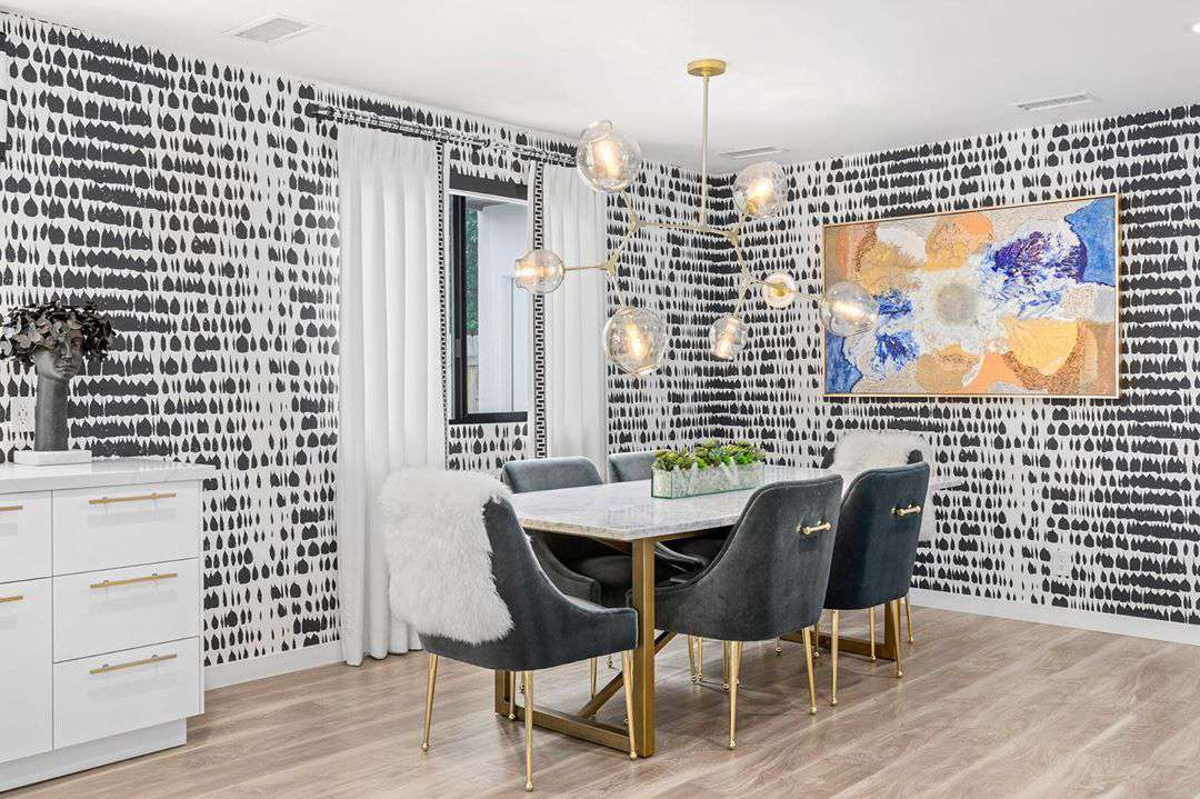 Dining room with black and white wallpaper