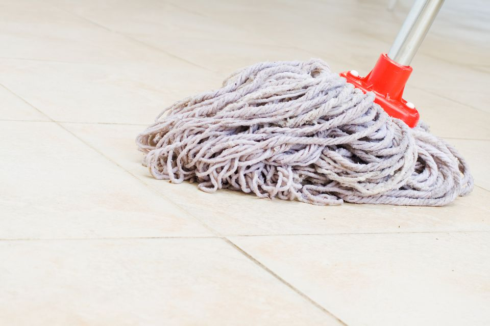 a rope mop on a floor
