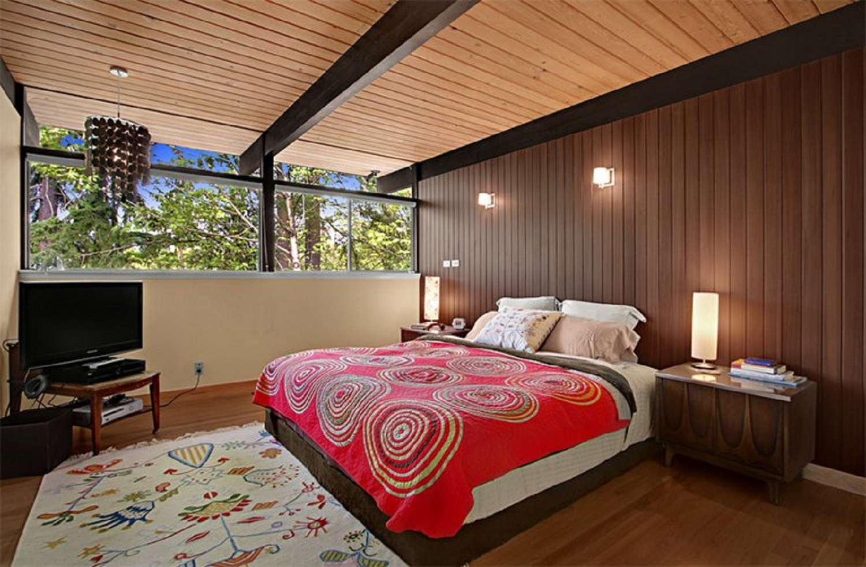 Modern bedroom with wood paneling