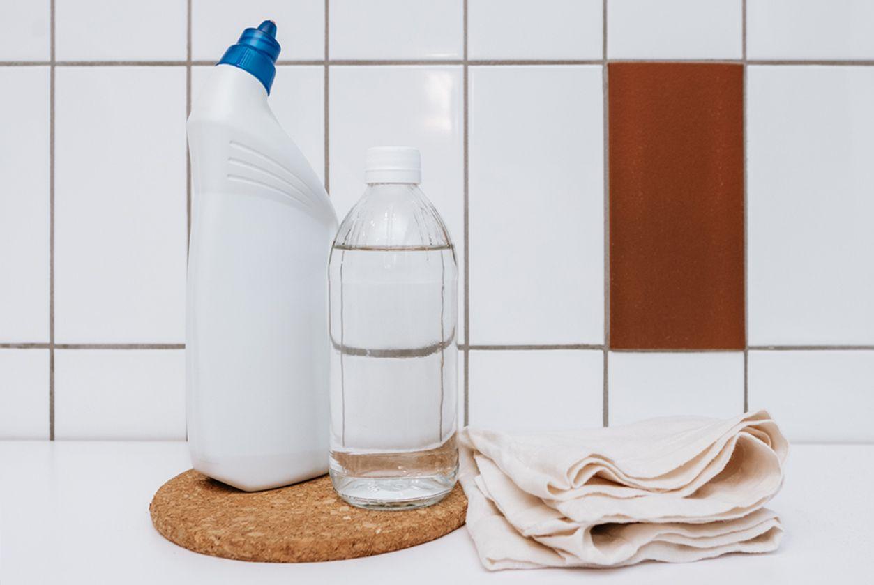 chlorine bleach, vinegar, and cloths