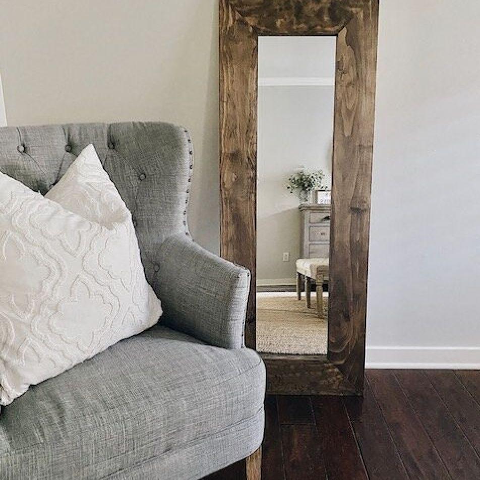 a full-length DIY mirror frame in rustic wood