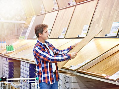 Man shopping for wood floorboards