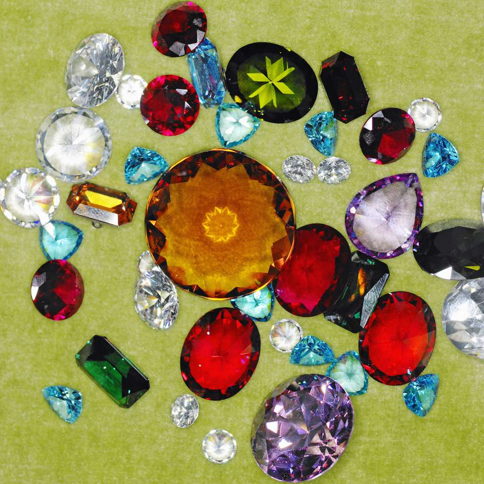 Assorted gemstones on a green background