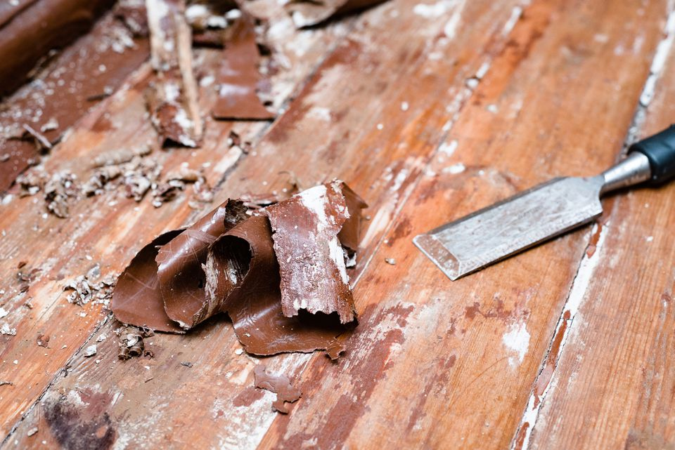 removing paint from the floor with a hot air gun repair tools