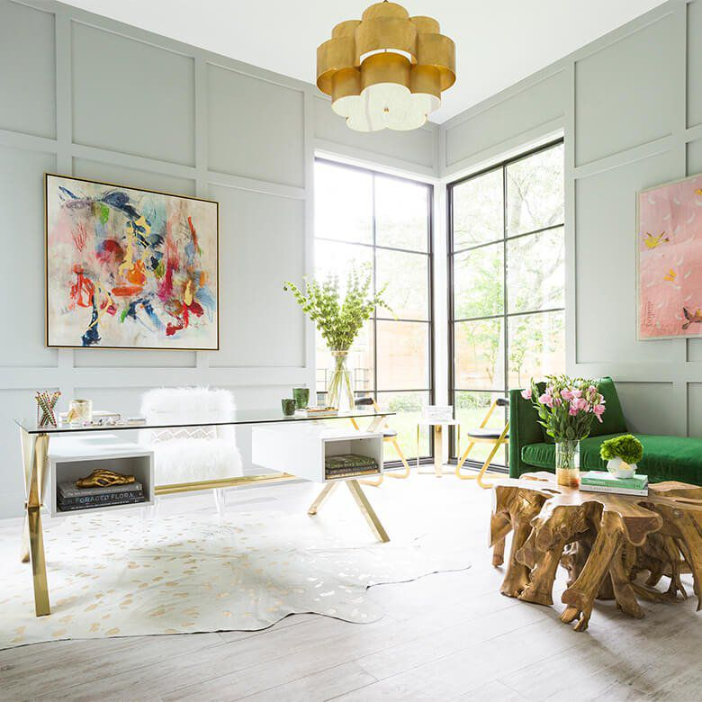 Chic room with glass desk and gold chandelier