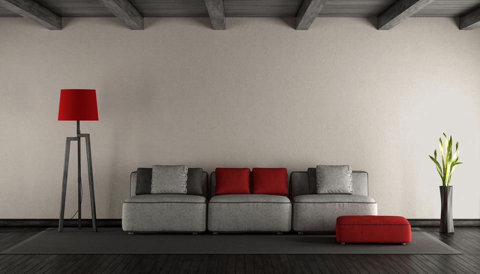 Interior of modern home with grey couch and red accents