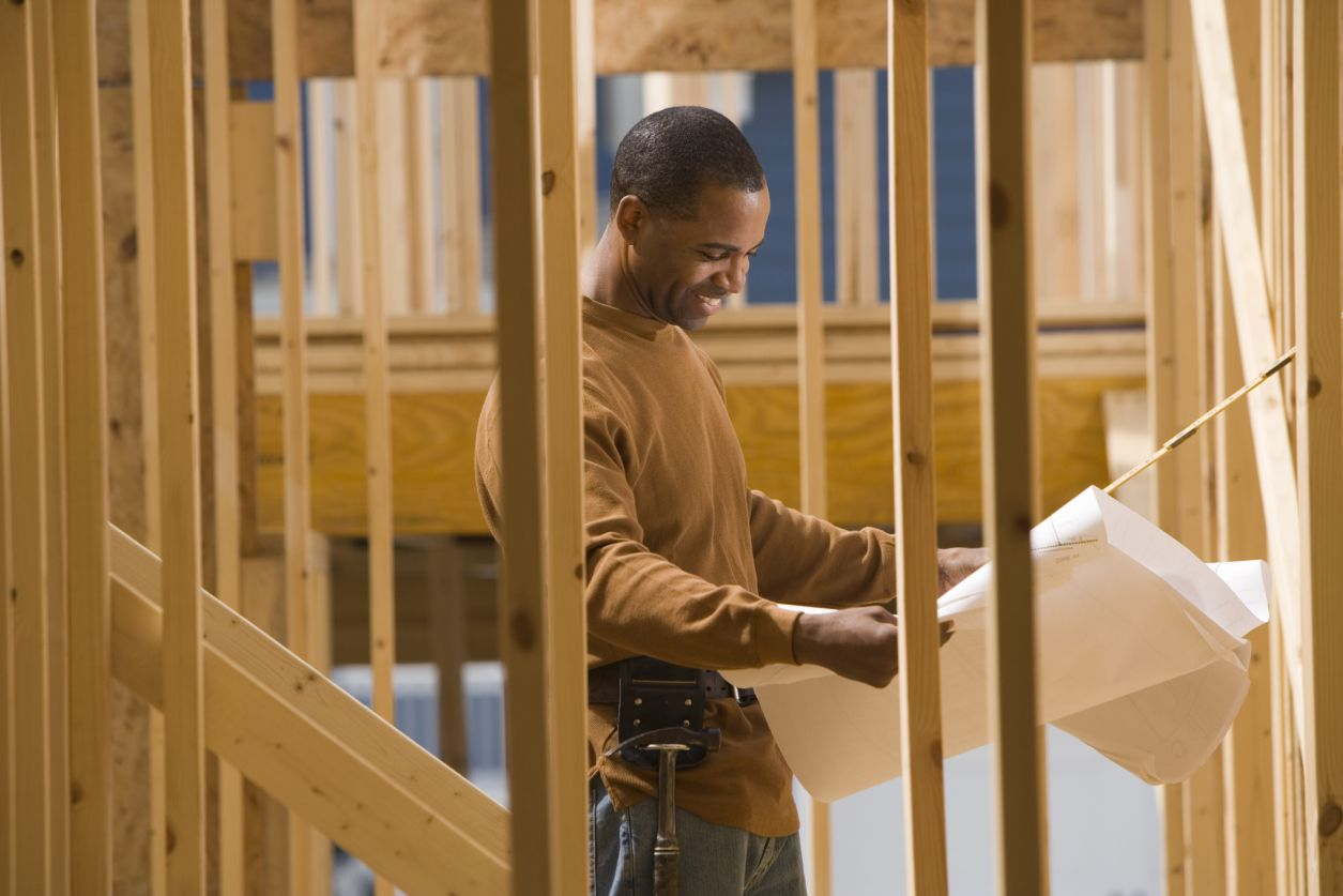 A construction worker framing a home