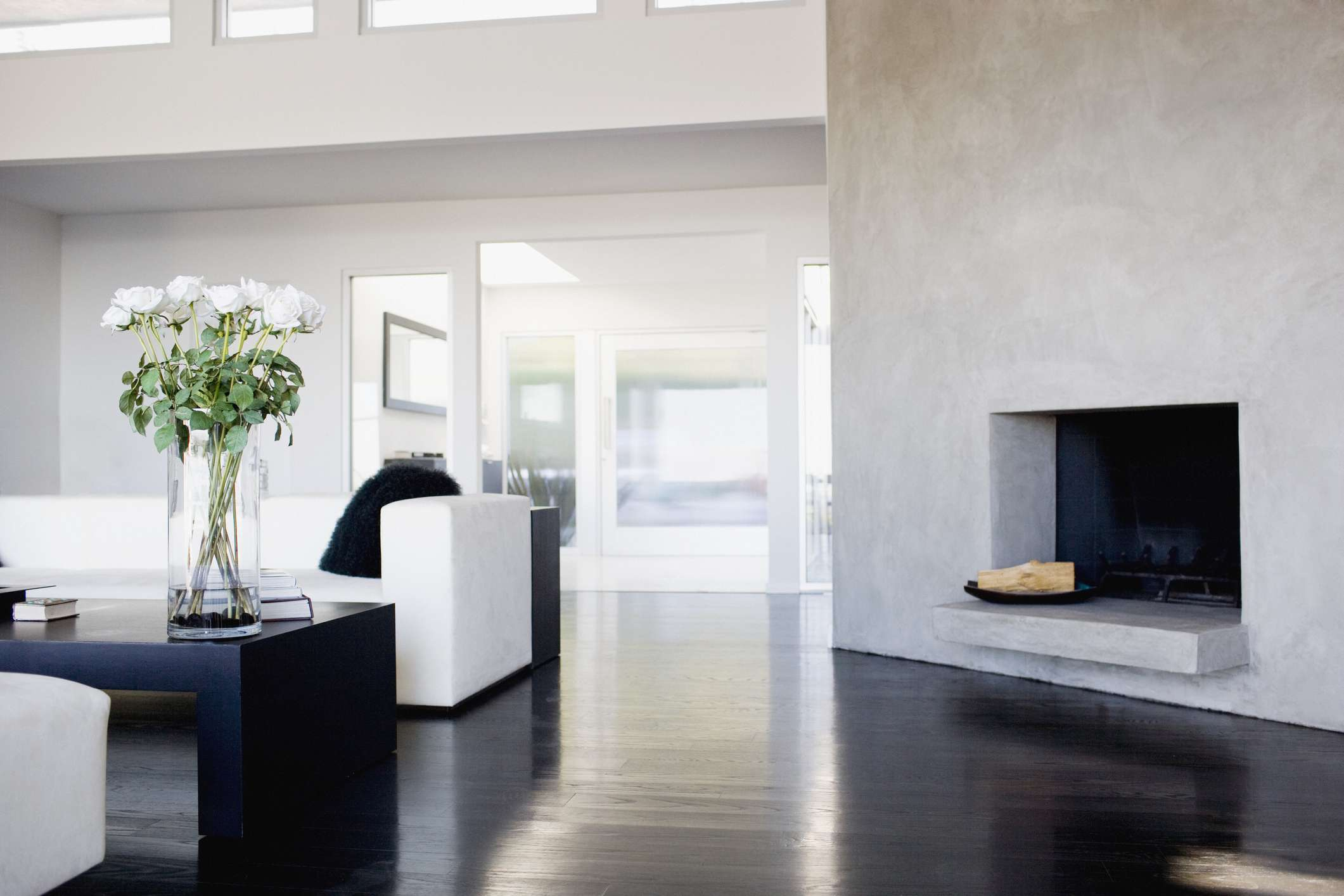 Modern living room with white roses on a black coffee table