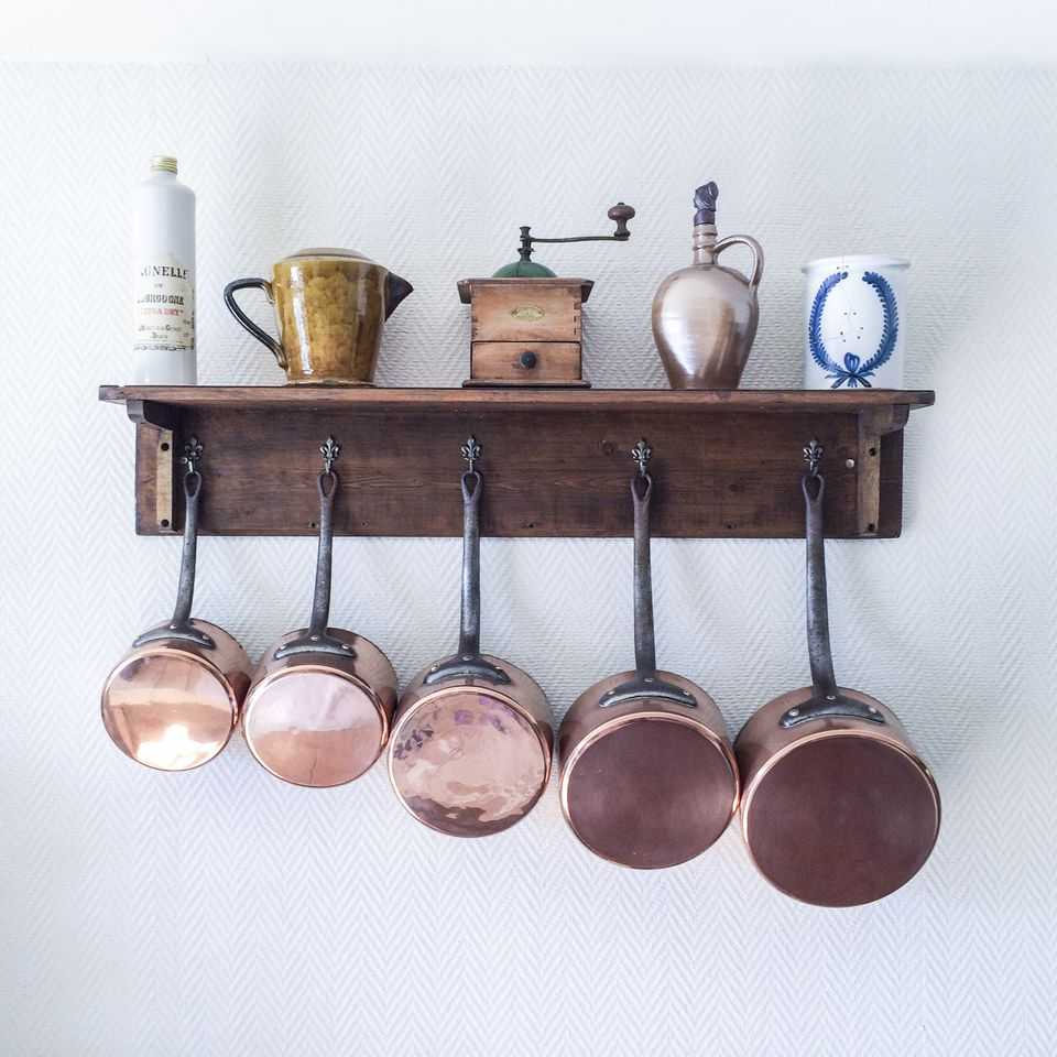 Wall shelf with pots and pans