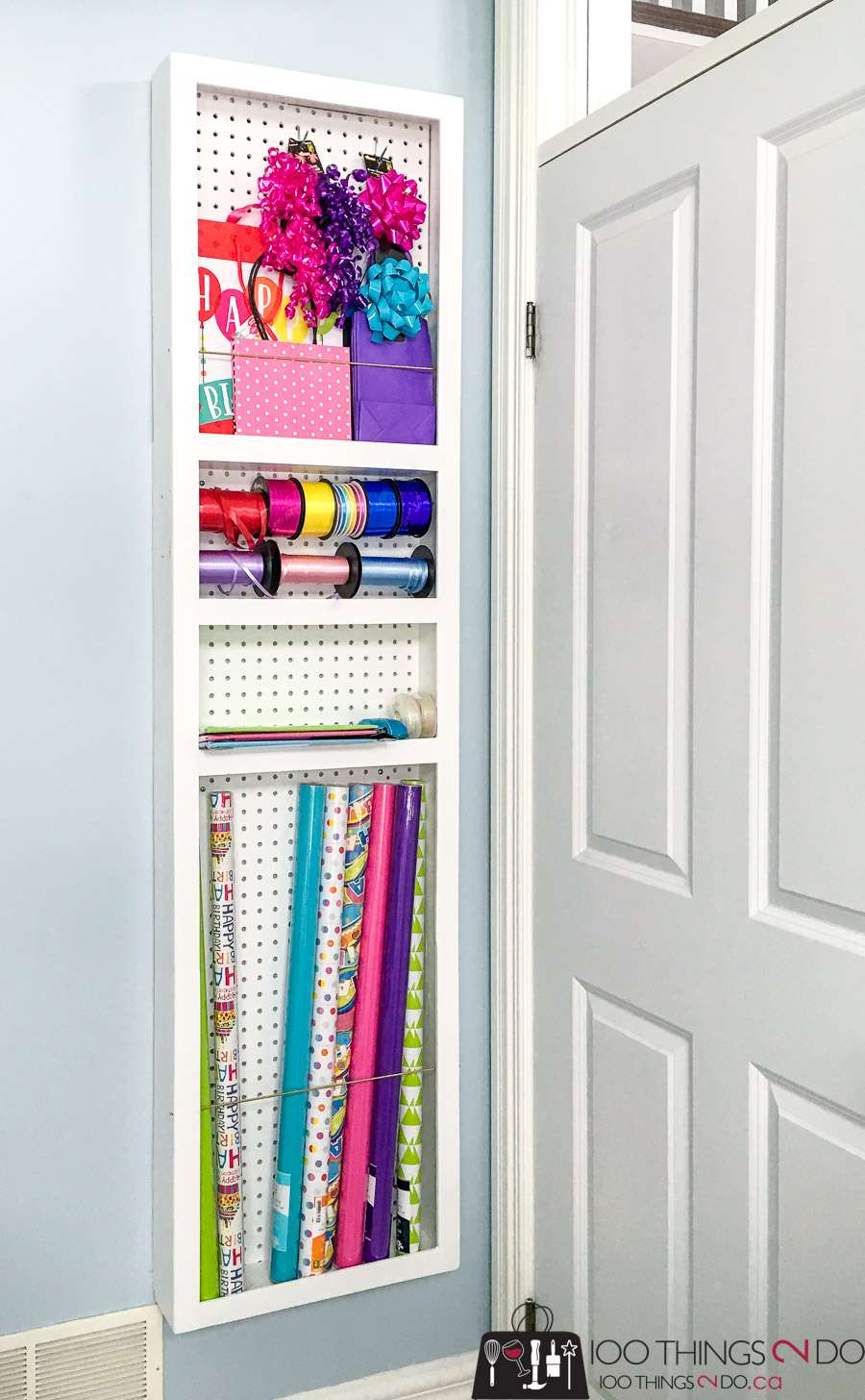wrapping paper storage custom built to fit behind a door
