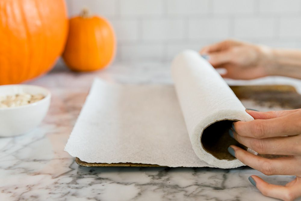 lining a cookie sheet with paper towels