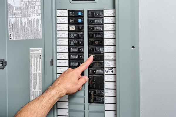 Circuit breaker switch being pressed in home service panel