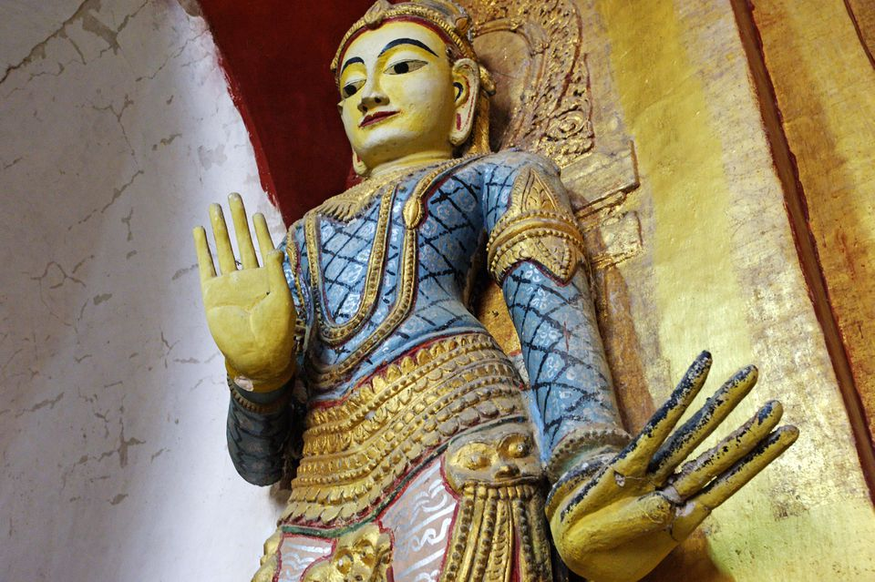 Myanmar, Burma, Mandalay Region, Bagan. In Ananda Pahto, or Ananda Temple, a subsidiary statue of a Bodhisattva displays mudras, or hand gestures.