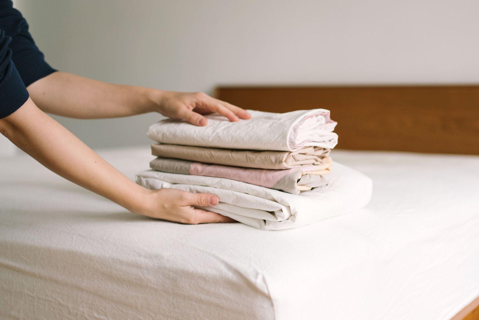 folding fresh linens