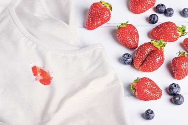 white shirt stained with berries