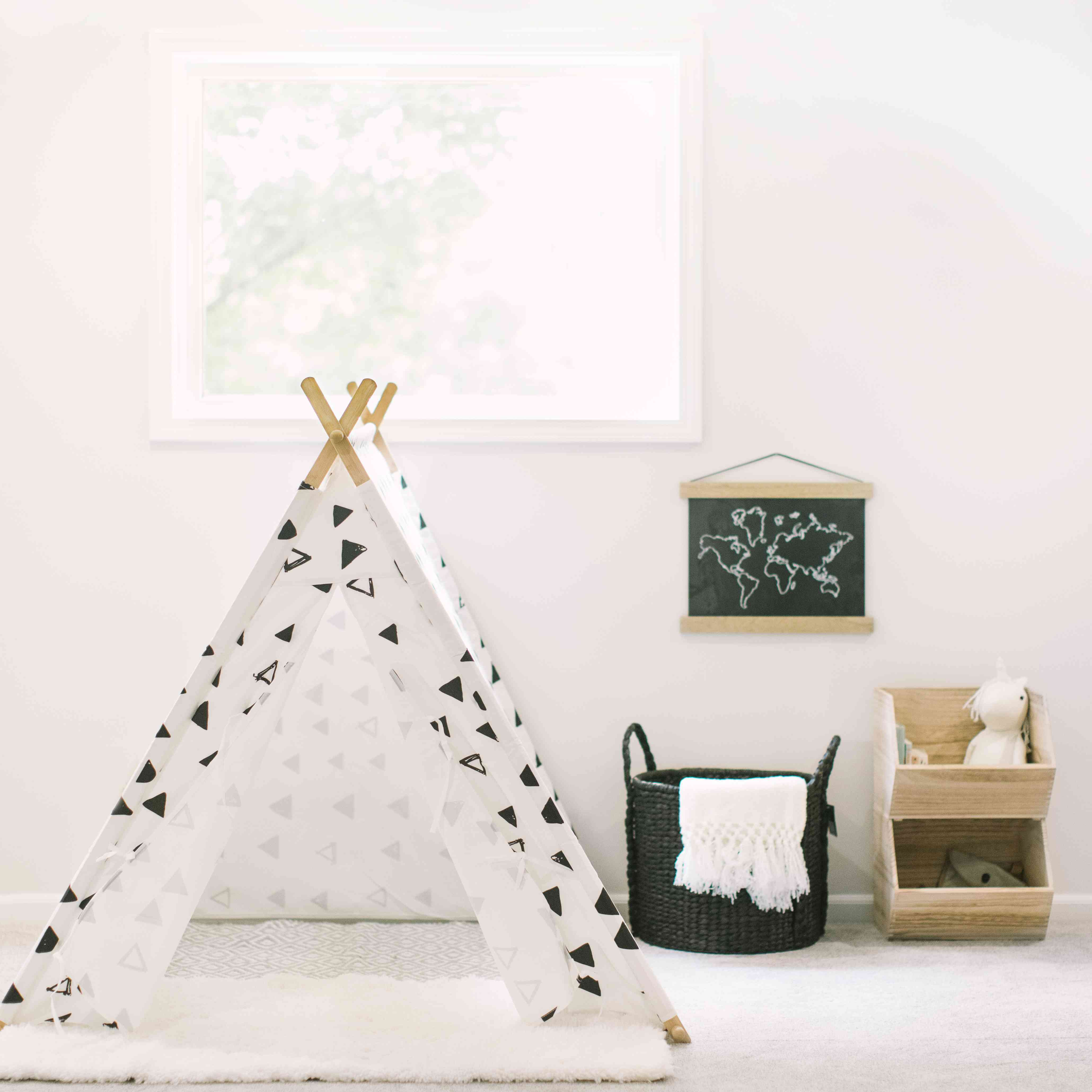 black and white playroom with teepee