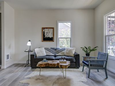 rustic and minimal living room with a tree trunk coffee table with hairpin legs