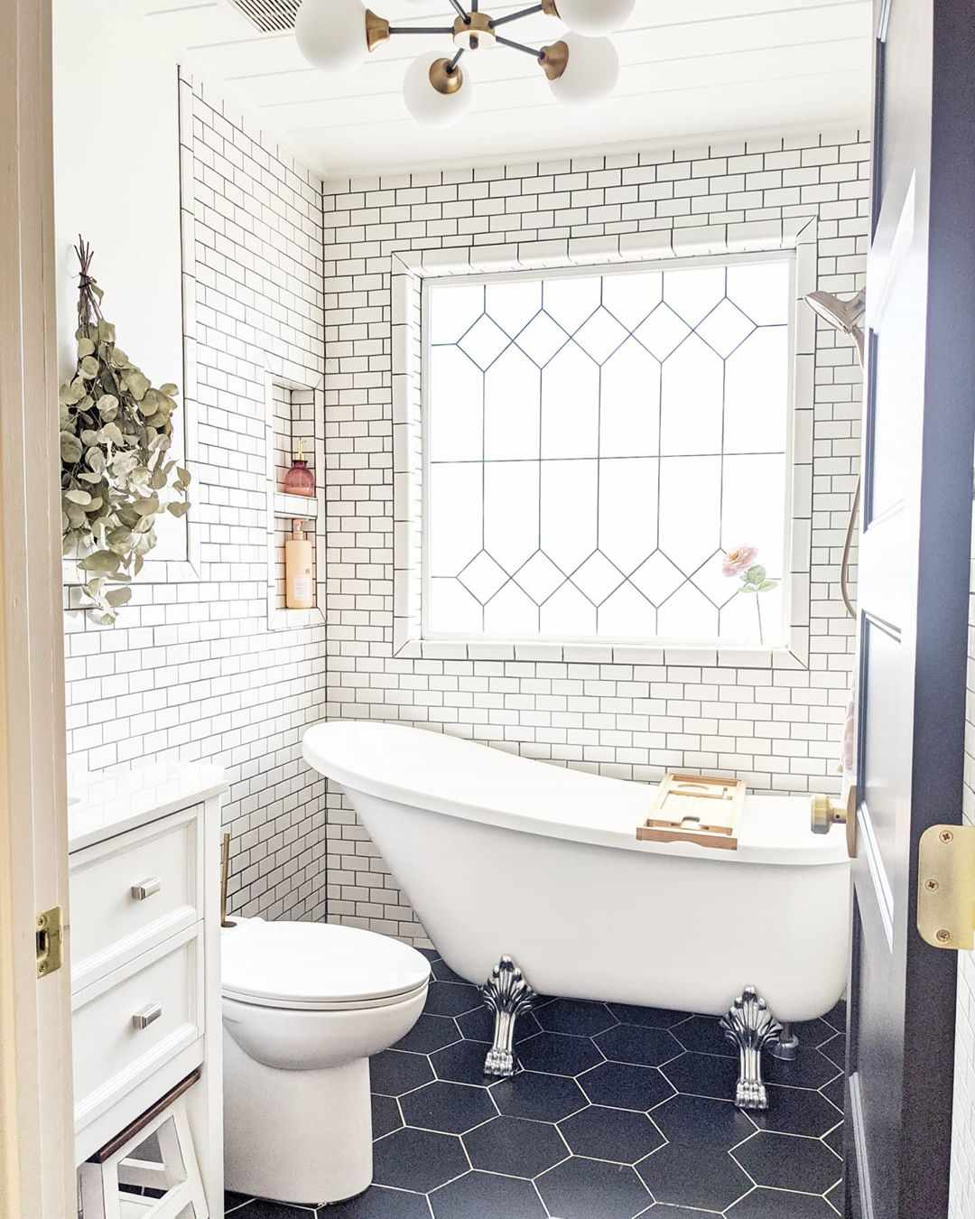 Bathroom with subway tile to the ceiling