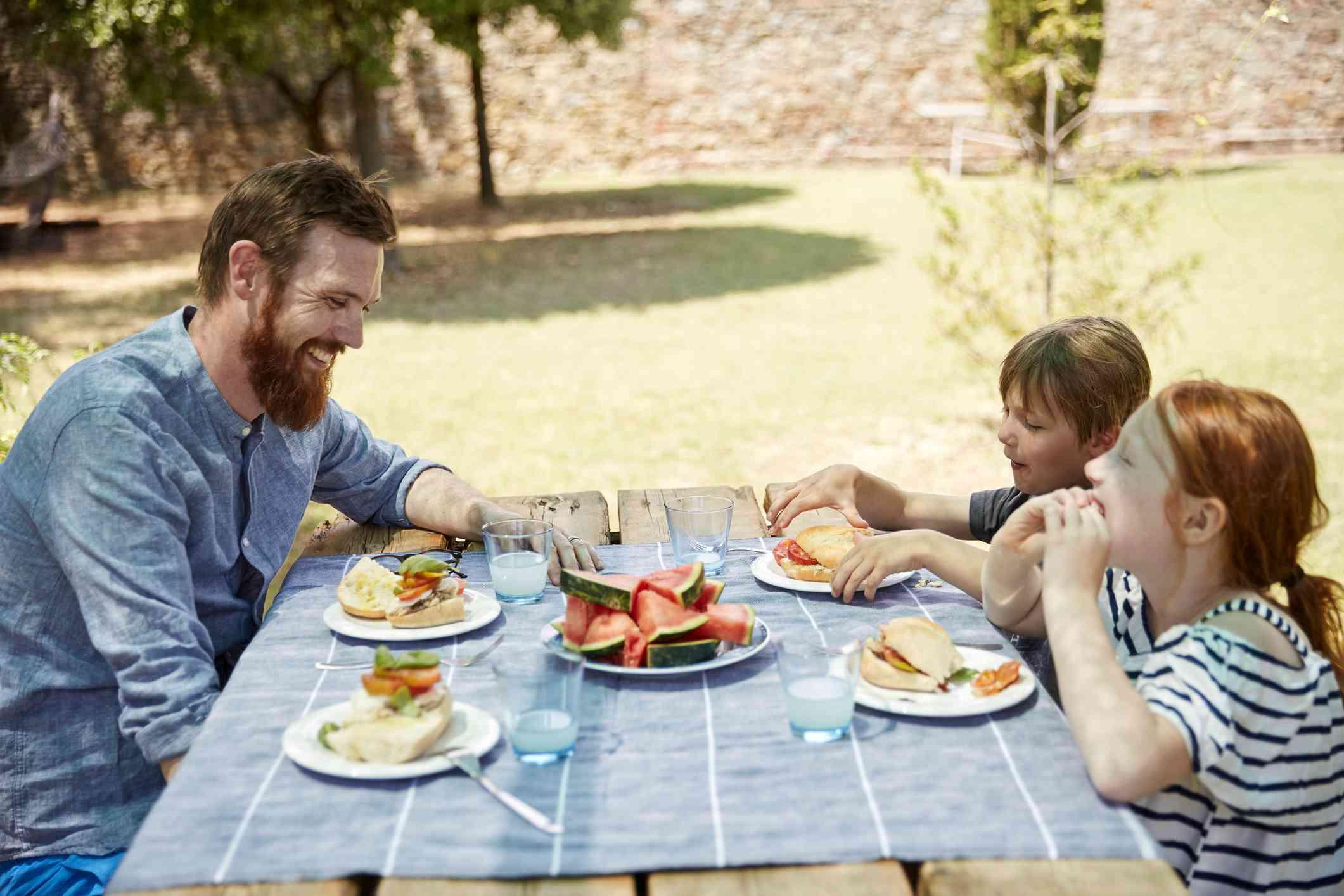 A family eating dinner outside.