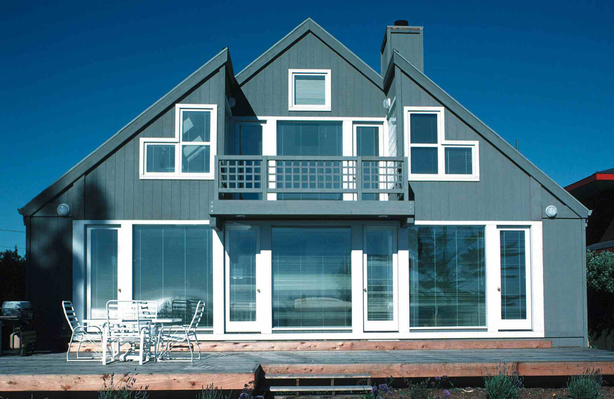 """This home is sided with """"T 1-11"""" siding panels, which have shiplapped edges and parallel grooves"""