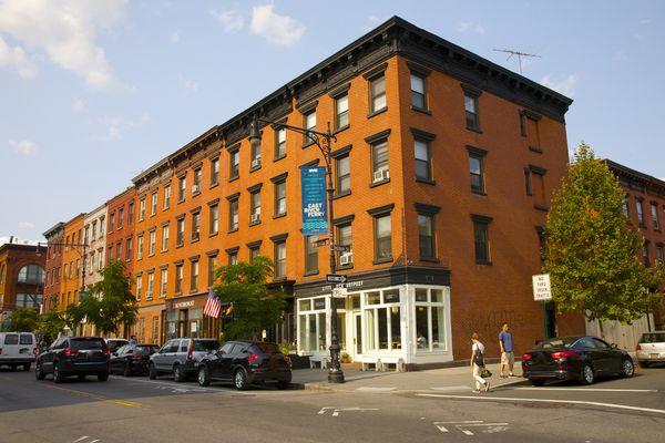 Orange brick building facades above retailers