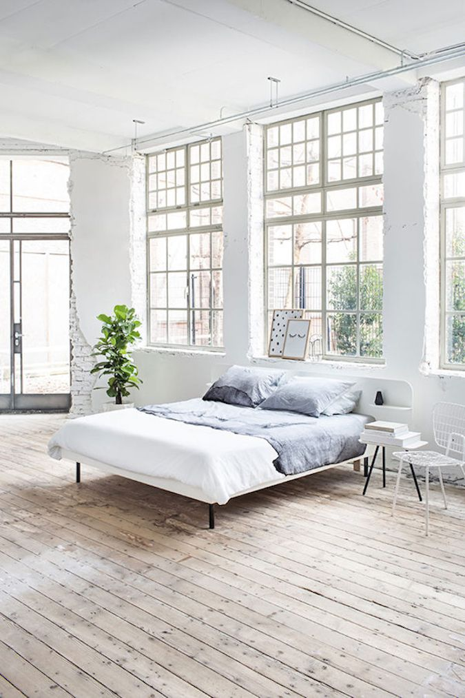 white bedroom with exposed brick