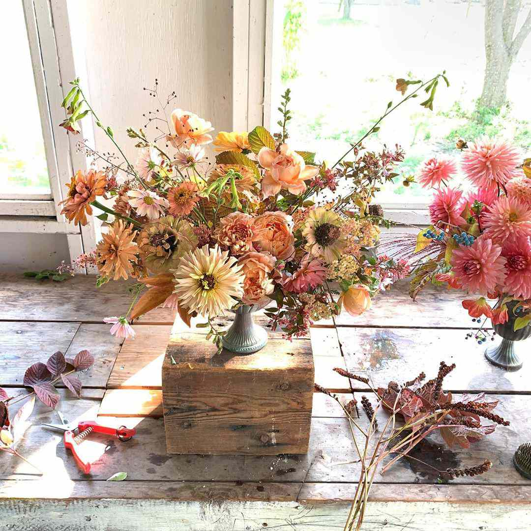 Floral bouquet sitting on wooden box