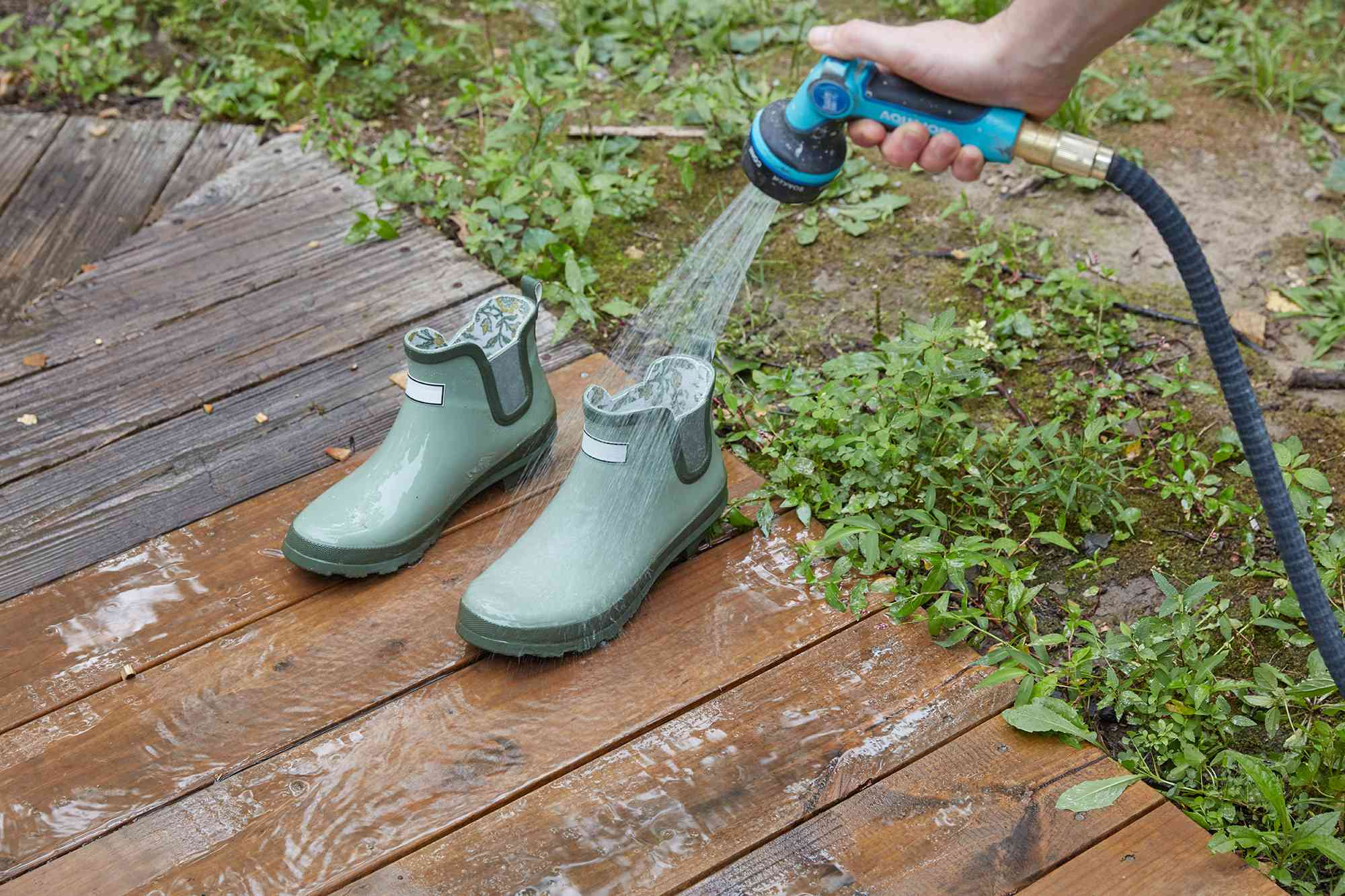 Rubber garden boots cleaned with soapy water from garden hose