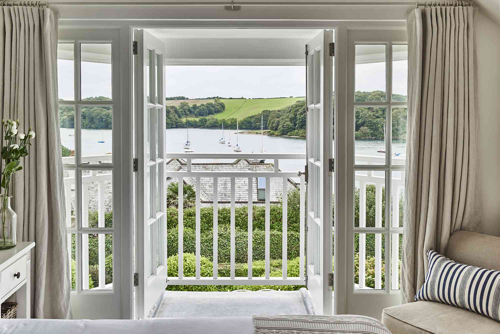 the view of the sailboats from the top floor bedroom of Emma Sims-Hilditch's Cornwall cottage
