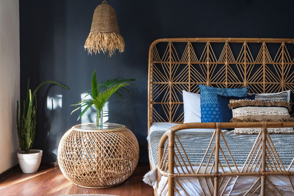 A bedroom with rattan furniture
