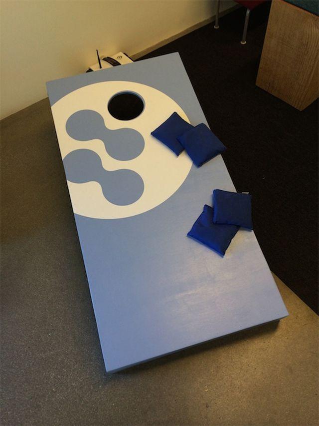 A blue and white cornhole board