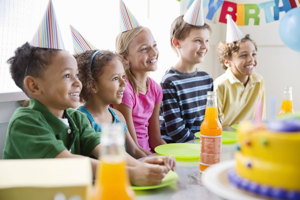 Cheerful multi-ethnic children celebrating birthday party