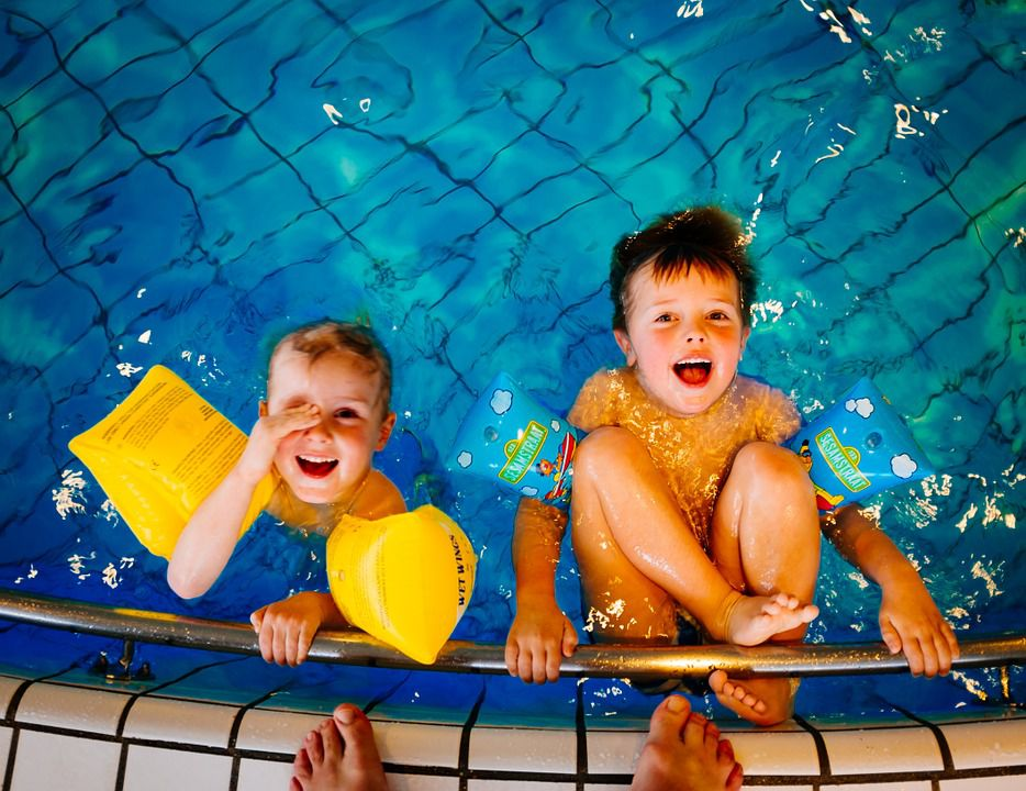 Kids enjoying a hotel swimming pool