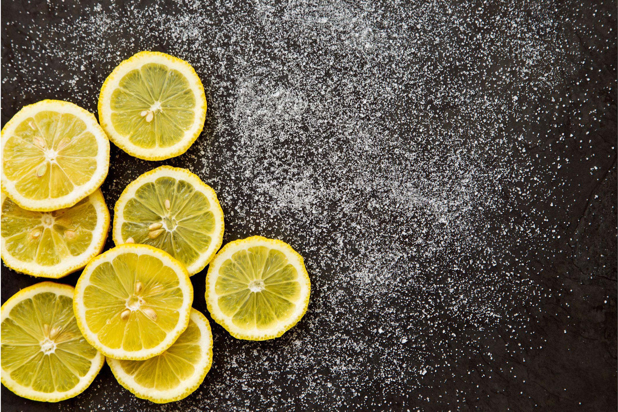 Lemon slices against a black background.