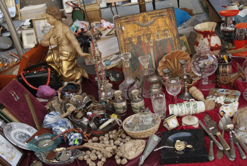 antique artwork and silver for sale at antique show flea market