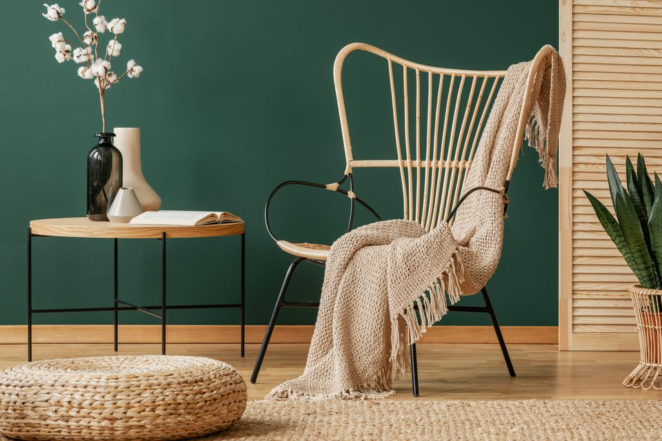 Wicker chair indoors with blanket