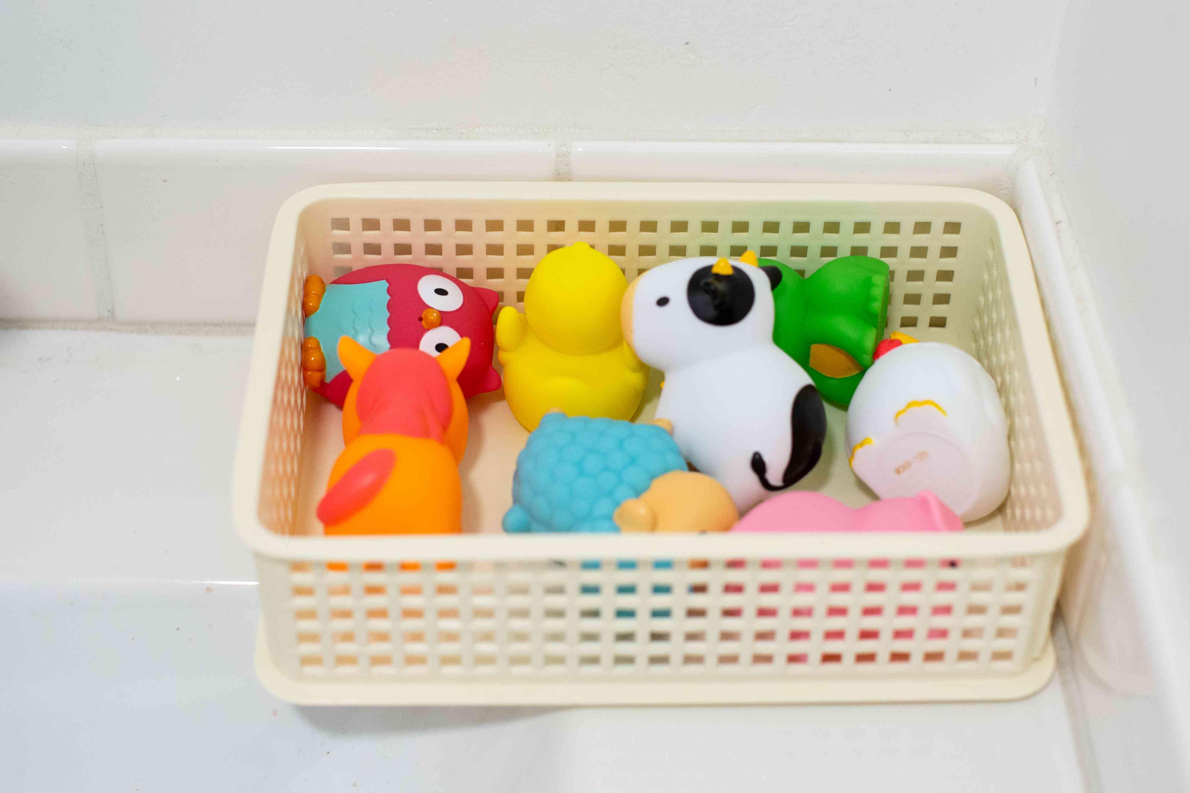bath toys organized in a basket