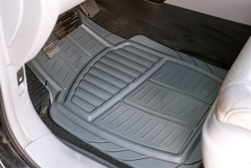 Clean and gray rubber car mat in front seat car floor