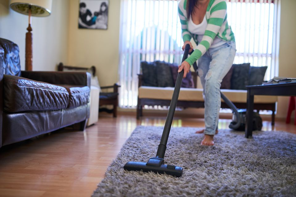 Woman vacuuming her living room