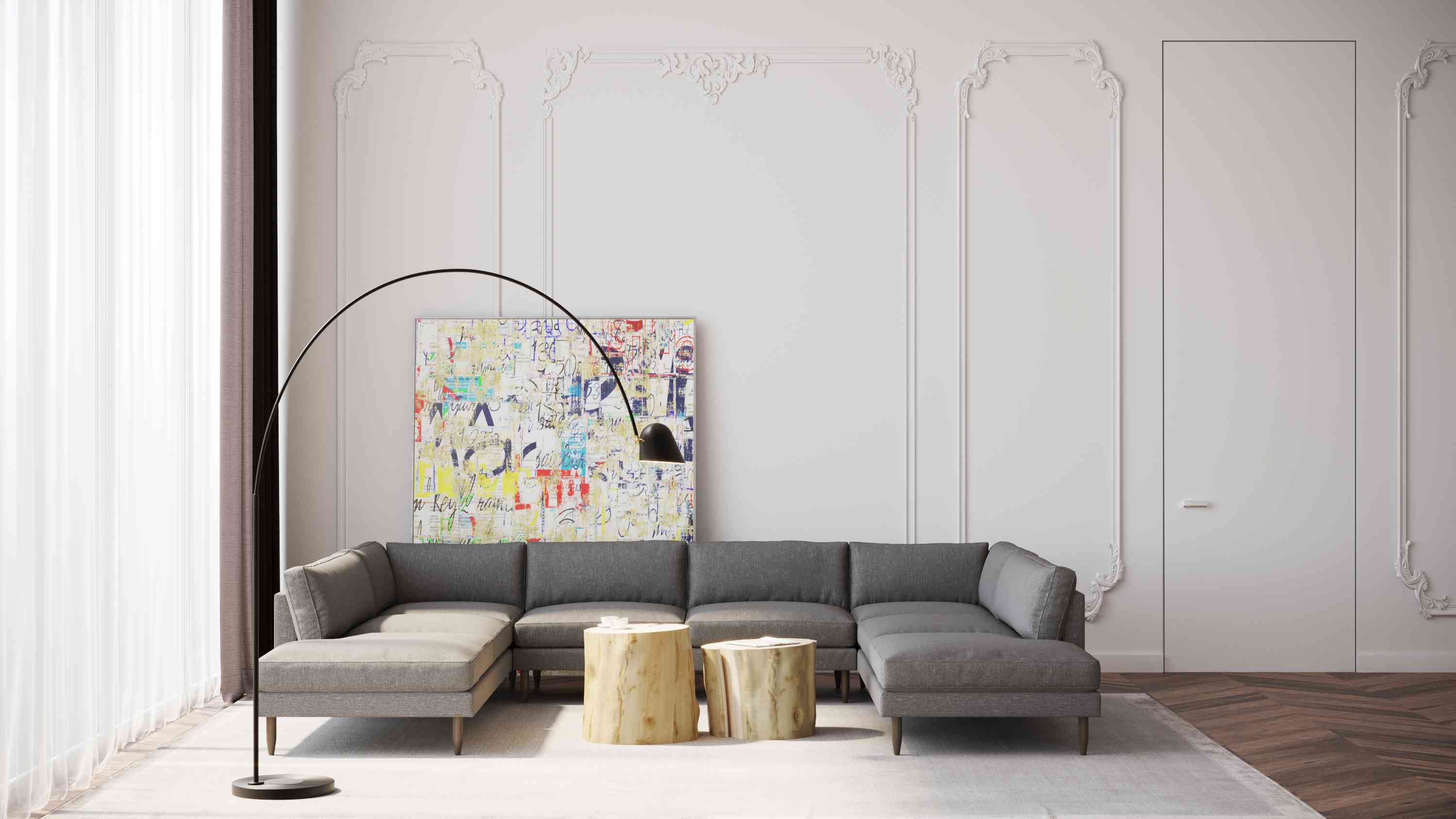 gray sectional sofa in room with tall, textured white walls