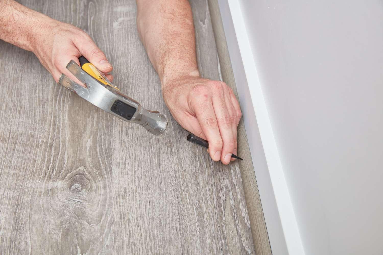 Flatten nails in baseboard
