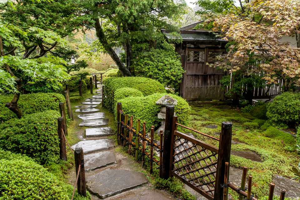 Japanese garden with stone walkways.