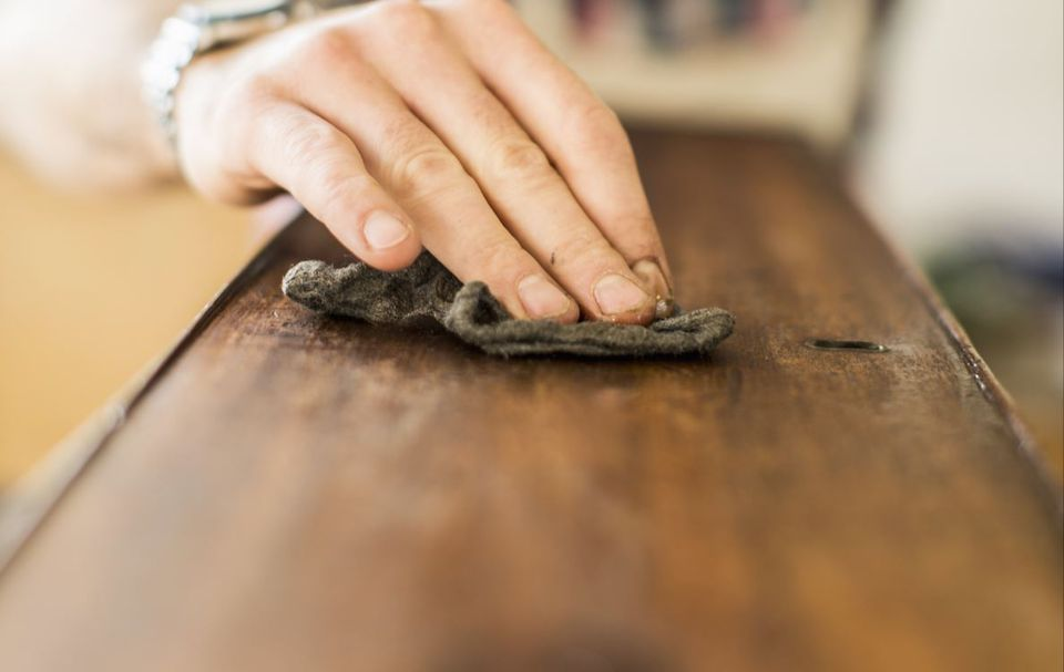 Using a Tack Cloth on Wood Surface