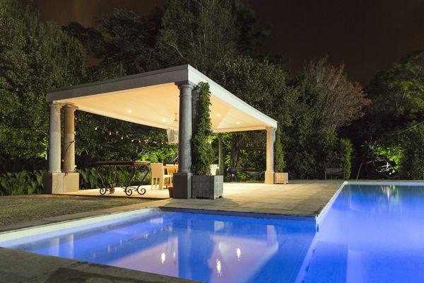 Illuminated gazebo at poolside