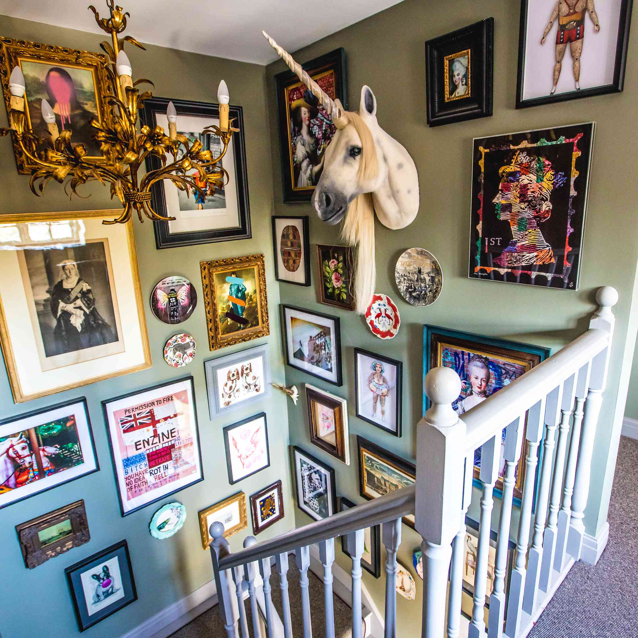 maximalist gallery wall in stairwell