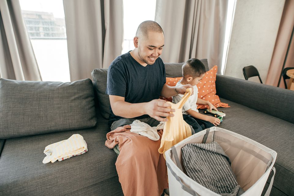 Father and Son Folding Clothes