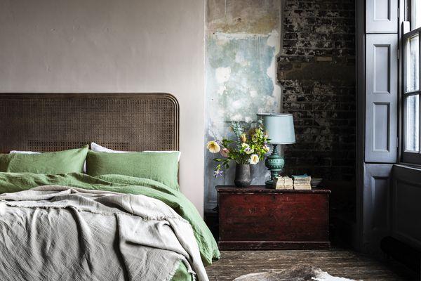 Bedroom featuring Piglet green linen sheets